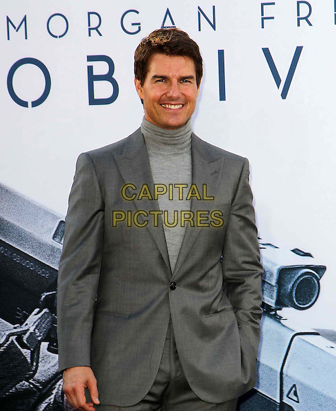 "Tom Cruise.""Oblivion"" Los Angeles Premiere held at the Dolby Theatre, Hollywood, California, USA..April 10th, 2013.half length grey gray turtleneck polo neck high collar suit hand in pocket .CAP/ADM/KB.©Kevan Brooks/AdMedia/Capital Pictures."