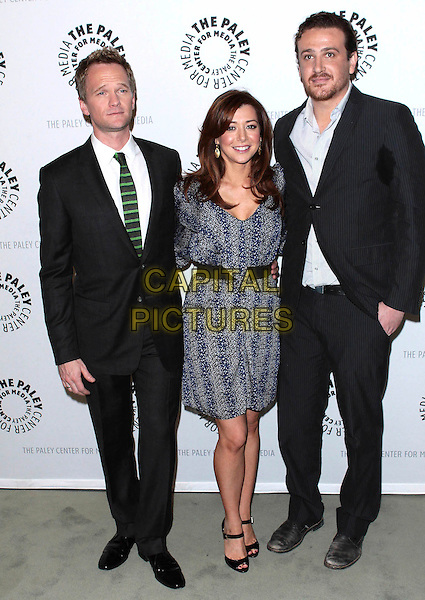 "NEIL PATRICK HARRIS, ALYSON HANNIGAN & JASON SEGEL .The Paley Center for Media presents ""How I Met Your Mother: 100th Episode Celebration"" held at The Paley Center for Media, Beverly Hills, California, USA,.7th  January 2010..full length  black green striped tie white shirt suit grey gray blue pinstripe print dress patent shoes open peep toe waistband .CAP/ADM/TC.©T. Conrad/AdMedia/Capital Pictures."