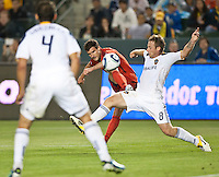 CARSON, CA – June 3, 2011: DC United midfielder Chris Pontius (13) attempts to pass thru LA Galaxy midfielder Chris Birchall (8) and defender Omar Gonzalez (4) during the match between LA Galaxy and DC United at the Home Depot Center in Carson, California. Final score LA Galaxy 0, DC United 0.