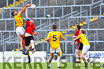 David Hallissey Kenmare Shamrocks and Damien Somers Feale Rangers compete the high ball during the SFC clash in Fitzgerald Stadium on Sunday