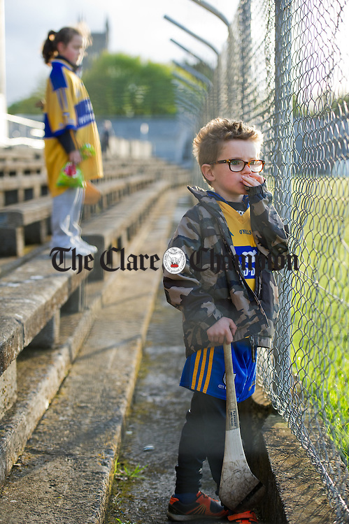 Ryan Hayes of Tulla, patiently waits to meet his sporting heroes during the Clare GAA Open Night as part of the national  launch of this years Championship. Photograph by John Kelly.
