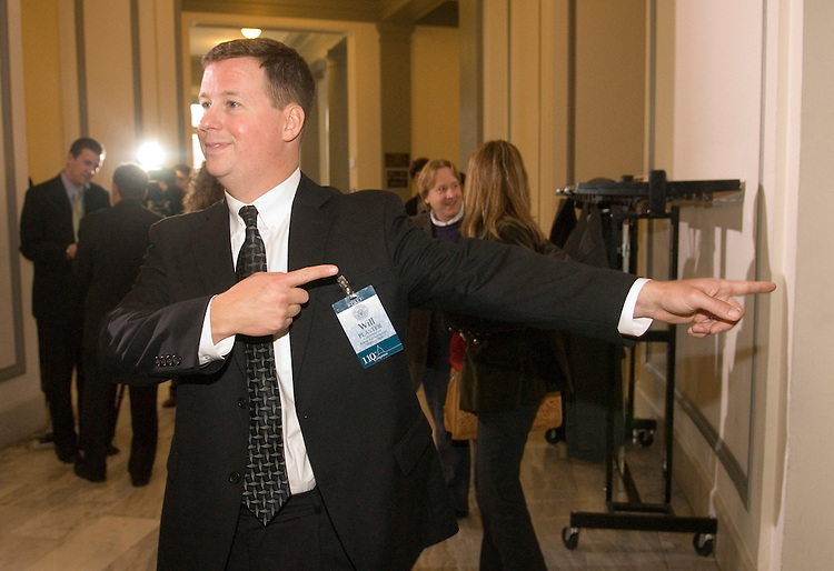 Will Plaster, a staff member with the Committee on House Administration, guides new members to the meeting room as they arrive in the Cannon House Office Building for freshman member orientation in Congress in Washington on Monday morning, Nov. 13, 2006.