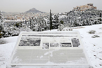 Pictured: The snow covered ancient monument of the Acropolis, Athens, Greece. Tuesday 10 January 2017<br />