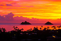 The sunrise at Lanikai beach with the Moku Lua islands off shore