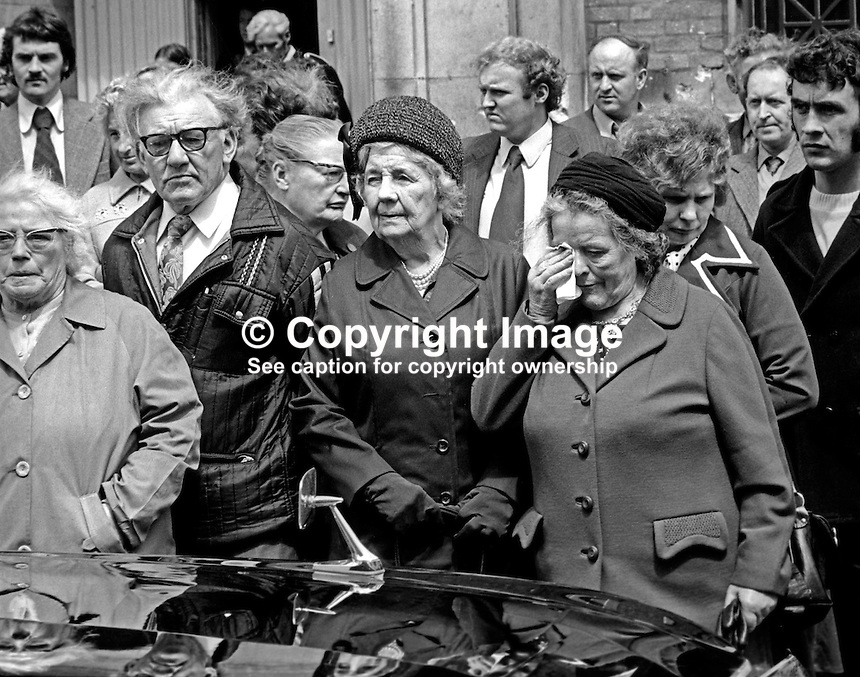 Funeral of N Ireland comedian James Young, 9th July 1974. A woman sheds a tear as the hearse passes through Belfast, N Ireland. 197407090382g<br /> <br /> Copyright Image from Victor Patterson, 54 Dorchester Park, Belfast, UK, BT9 6RJ<br /> <br /> t1: +44 28 9066 1296<br /> t2: +44 28 9002 2446<br /> m: +44 7802 353836<br /> <br /> e1: victorpatterson@me.com<br /> e2: victorpatterson@gmail.com<br /> <br /> www.victorpatterson.com<br /> <br /> IMPORTANT: Please see my Terms and Conditions of Use at www.victorpatterson.com