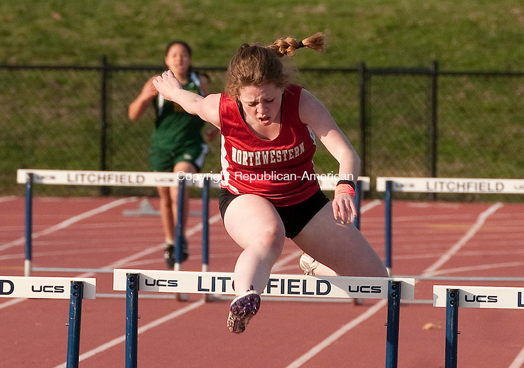 LITCHFIELD, CT--042115JS15- Northwestern's Maggie Dahill took first in the low hurdles during their Berkshire League track meet Tuesday at the Plumb Hill sports complex at Litchfield High School. They competed with Wamogo, Thomaston and O'Brien Tech. <br /> Jim Shannon Republican-American