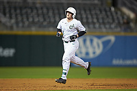 Harris Yett (8) of the Charlotte 49ers rounds the bases after hitting a home run against the Clemson Tigers at BB&T BallPark on March 26, 2019 in Charlotte, North Carolina. The Tigers defeated the 49ers 8-5. (Brian Westerholt/Four Seam Images)