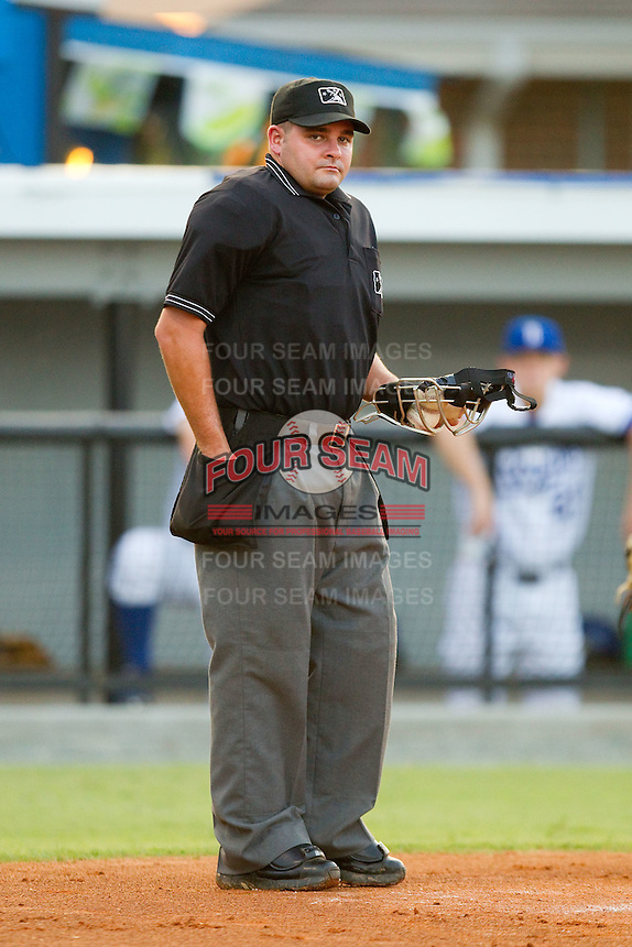 Home plate umpire Jeremy Riggs reloads his ball bag during an Appalachian League game between the Bristol White Sox and the Burlington Royals at Burlington Athletic Stadium August 13, 2010, in Burlington, North Carolina.  Photo by Brian Westerholt / Four Seam Images
