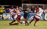 Chris Wondolowski kicks the ball surround by FC Dallas players. FC Dallas defeated the San Jose Earthquakes 2-1 at Buck Shaw Stadium in Santa Clara, California on October 7, 2009.