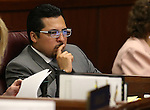 Nevada Assemblyman Edgar Flores, D-Las Vegas, works on the Assembly floor at the Legislative Building in Carson City, Nev., on Sunday, May 31, 2015.  <br /> Photo by Cathleen Allison