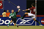 3 August 2004: Marco Del Vecchio (9) tries to intercept a throw by Jerzy Dudek (left). Liverpool of the English Premier League defeated AS Roma of Italy's La Liga 2-1 at Giants Stadium in the Meadowlands Complex in East Rutherford, NJ in a ChampionsWorld Series friendly match..
