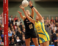 09.06.2011 Silver Ferns Irene Van Dyk and Australian Diamonds Julie Corletto in action during the netball match between the Silver Ferns and Australia held at Arena Manuwau in Palmerston North. Mandatory Photo Credit ©Michael Bradley.