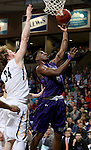SIOUX FALLS, SD - FEBRUARY 27:  Kebu Johnson #4 from the University of Sioux Falls lays the ball up past Daniel Jansen #34 from Augustana during their NSIC Tournament game Saturday night at the Pentagon in Sioux Falls. (Photo by Dave Eggen/Inertia)