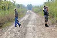 NWA Democrat-Gazette/FLIP PUTTHOFF <br /> David Oakley (left) and Joe Neal look for dragonflies and birds Sept. 16 2016 at Frog Bayou Wildlife Managment Area near Alma.