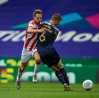 4th July 2020; Bet365 Stadium, Stoke, Staffordshire, England; English Championship Football, Stoke City versus Barnsley; Nick Powell of Stoke City is fouled by Cameron McGeehan of Barnsley