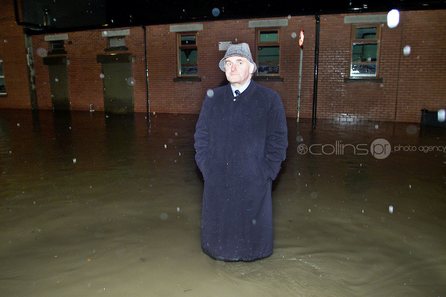 15/11/02 TAOISEACH BERTIE AHERN SURVEYS THE DAMAGE AFTER THE RIVER TOLKA BURST IT'S BANKS EARLY THIS MORNING....PICTURE COLIN KEEGAN, COLLINS, DUBLIN.