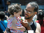 Close up of a young girl being introduced to watermelon at the 11th Annual Mid-town Make a Difference Day Celebration on Franklin Street, in Kingston, NY on Saturday, June  18, 2016. Photo by Jim Peppler. Copyright Jim Peppler 2016.
