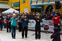 Signers help with National Anthem  at 4th Avenue and D street in downtown Anchorage, Alaska on Saturday March 7th during the 2020 Iditarod race. Photo copyright by Cathy Hart Photography.com