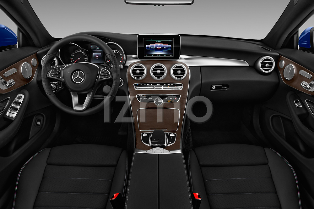 Stock photo of straight dashboard view of 2017 Mercedes Benz C-Class - 2 Door Convertible Dashboard