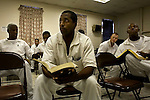 A bible study session with Pastor Daniel at the carol s. vance prison in sugarland, texas during a bible study session.  the carol s. vance unit is one of the handful of prisons in the USA managed by evangelical christian pastors who use a bible-centered program for rehabilitation and counseling.  from daybreak to lights out, the prisoners are put through a series of spiritual and religious exercises, lectures, discussion groups asked to bring christ back into their life.  the program is also the prisoner's principal if not the only support chain once they leave the prison and return to society.