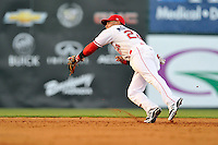 Second baseman Yoan Moncada (24) of the Greenville Drive snags a line drive in the fifth inning of a game against the Augusta GreenJackets on Thursday, July 16, 2015, at Fluor Field at the West End in Greenville, South Carolina. The Cuban-born 19-year-old Red Sox signee has been ranked the No. 1 international prospect in baseball by Baseball America. Greenville won, 11-5. (Tom Priddy/Four Seam Images)