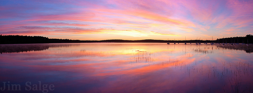 A beautiful sunrise over Lake Massabesic in Manchester, New Hampshire.