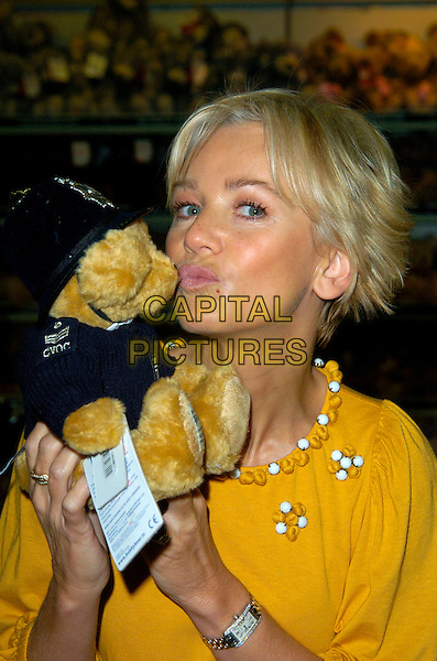 LISA MAXWELL.At a photocall to launch Bobby Bear at Hamley's, Regent Street,London, England, October 20th 2007..50% of profits from the sale of the bear, dressed in a policeman's helmet, with a branded Metropolitan police jumper, will go to the charity Child Victims of Crime (CVOC) - the national police children's charity, which provides emotional and practical support to children who have been victims of crime..portrait headshot pouting.CAP/CAN.©Can Nguyen/Capital Pictures