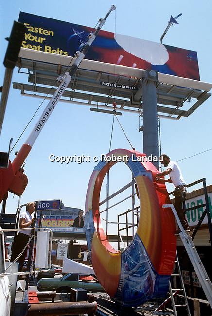 Installation of ELO billboard extension piece on the Sunset Strip circa 1979