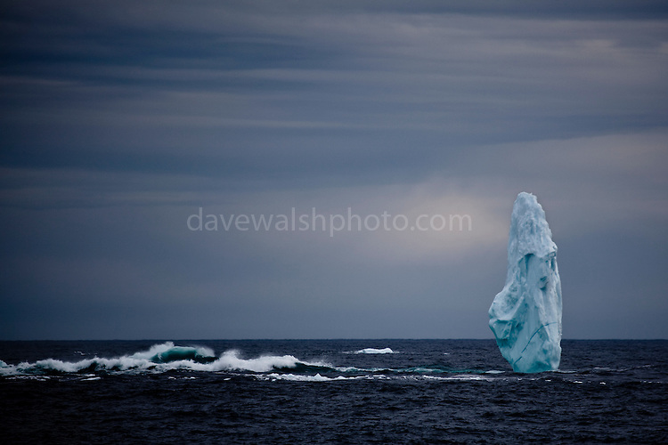 Pinnacle of ice near the mouth of Kangerlugussuaq Fjord, East Greenland. The structure is part of a large iceberg, not pictured, worn away by wind and waves.