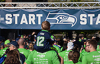 Father giving his son shoulder ride, Seahawks 12K Run 2016, The Landing, Renton, Washington, USA.