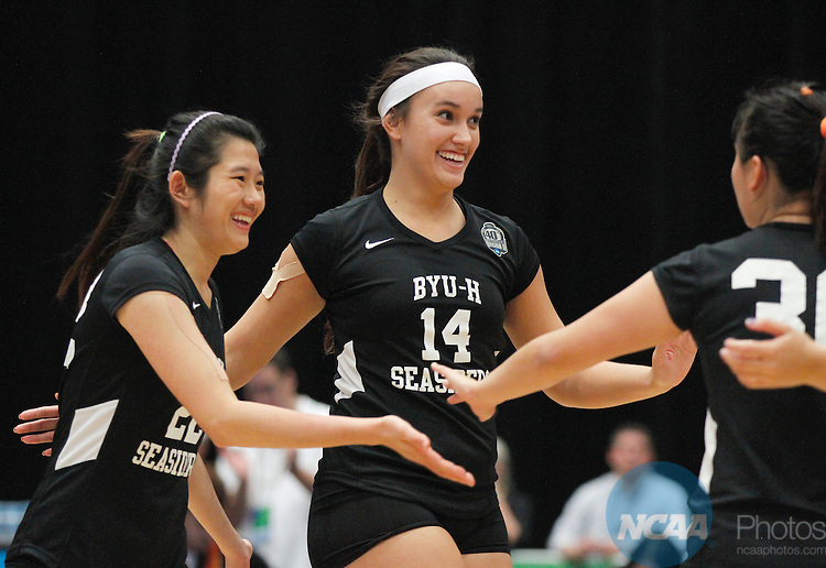 14 DEC 2013: Noel Pauga (14) of BYU-Hawaii celebrates a point with her teammates during the Division II Women's Volleyball Championship game held at the U.S. Cellular Center in Cedar Rapids, IA.  Concordia-St. Paul won over BYU-Hawaii in 3 straight sets to claim the championship title.   <br />