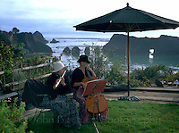 Flute and cello players on lawn near Elk California on the Mendocino Coast