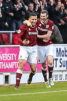 Rod McDonald of Northampton Town (left) celebrates scoring his team's third goal against Morecambe with Zander Diamond of Northampton Town (right) during the Sky Bet League 2 match between Northampton Town and Morecambe at Sixfields Stadium, Northampton, England on 23 January 2016. Photo by David Horn / PRiME Media Images.
