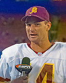 Washington Redskins quarterback Brad Johnson (14) is interviewed following the game against the New York Giants at Giants Stadium in East Rutherford, New Jersey on September 24, 2000.  The Redskins won the game 16 - 6.<br /> Credit: Arnie Sachs / CNP