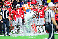 Indianapolis, IN - DEC 1, 2018: Ohio State Buckeyes head coach Urban Meyer is showered with Gatorade after defeating the Northwestern Wildcats 45-24 in the Big Ten Championship game at Lucas Oil Stadium in Indianapolis, IN. (Photo by Phillip Peters/Media Images International)