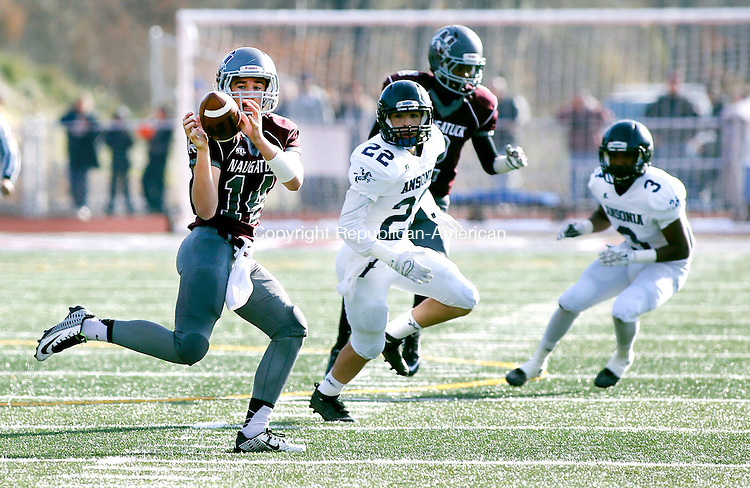 Naugatuck, CT- 26 November 2015-112615CM12-  Naugatuck's Tyler Deitlebaum keeps his eye on the ball as he makes a catch during their Thanksgiving matchup against Ansonia in Naugatuck on Thursday.  Defending is Ansonia's Grady Lawlor (22). The Chargers would rout the Greyhounds,  41-8.   Christopher Massa Republican-American