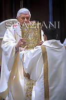 Pope Benedict XVI greets the faithful as he arrives at Albano's cathedral, on the outskirt of Rome, for a ceremony to bless a new altar, Sunday, Sept. 21, 2008.