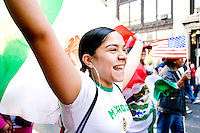 Erica waves the Mexican flag and marches down Broadway towards City Hall in New York City, protesting the United States immigration policy on May 1, 2006.