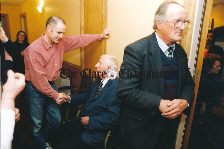 Gary Shannon has a word with fellow musician PJ Hayes during the official opening of the Fleadh Nua in the Temple Gate Hotel, Ennis - date unknown (1998-2000).