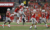 Ohio State Buckeyes cornerback Gareon Conley (8) celebrates his interception with Ohio State Buckeyes linebacker Chris Worley (35) during the fourth quarter of the NCAA football game between the Ohio State Buckeyes and the Tulsa Golden Hurricane at Ohio Stadium on Saturday, September 10, 2016. (Columbus Dispatch photo by Jonathan Quilter)
