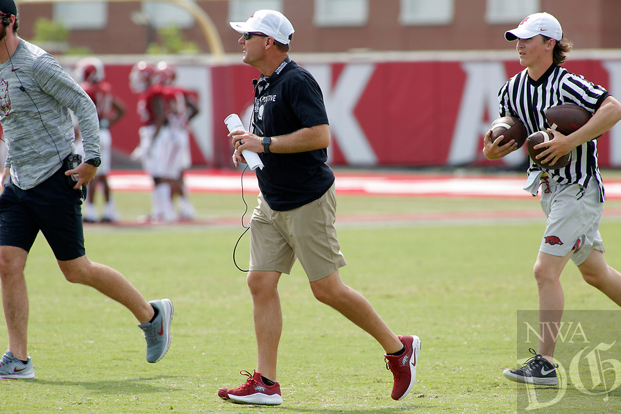 NWA Democrat-Gazette/DAVID GOTTSCHALK University of Arkansas Razorback head coach Chad Morris (center) watches drills Wednesday, August 8, 2018, during football practice on campus in Fayetteville.