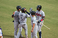Peoria Javelinas teammates Mario Feliciano (6), Chris Mariscal (19), and Izzy Wilson (7) congratulate Lucius Fox (5), of the Tampa Bay Rays organization, after hitting a home run during an Arizona Fall League game against the Mesa Solar Sox on October 11, 2018 at Sloan Park in Mesa, Arizona. The Solar Sox defeated the Javelinas 10-9. (Zachary Lucy/Four Seam Images)