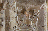 Carved capital depicting a seated Christ holding 2 chalices representing the eucharist, and a man gesturing in acceptance, in the Abbatiale Sainte-Foy de Conques or Abbey-church of Saint-Foy, Conques, Aveyron, Midi-Pyrenees, France, a Romanesque abbey church begun 1050 under abbot Odolric to house the remains of St Foy, a 4th century female martyr. The church is on the pilgrimage route to Santiago da Compostela, and is listed as a historic monument and a UNESCO World Heritage Site. Picture by Manuel Cohen