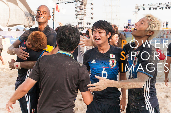 GOTO Takasuke of Japan celebrates with teammates after winning the Beach Soccer Men's Team Gold Medal Match between Japan and Oman on Day Nine of the 5th Asian Beach Games 2016 at Bien Dong Park on 02 October 2016, in Danang, Vietnam. Photo by Marcio Machado / Power Sport Images