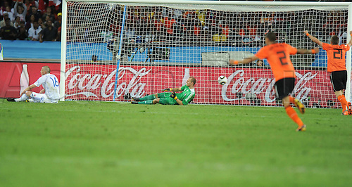 28 06 2010   Durban Jan Durica 1st l and Goalkeeper Jan Mucha 2nd l of Slovakia react AS Players of The Netherlands Celebrate A Goal during their 2010 World Cup Round of 16 Soccer Match AT Moses Mabhida stadium in Durban South Africa ON June 28 2010 Netherlands Won 2 1 and is qualified for The Quarter-finals
