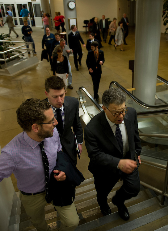UNITED STATES - : Sen. Al Franken, D-MN., talks with reporters as he walks through the Senate Subway to the U.S. Capitol on the way to the Caucus luncheons on April 18, 2013.  (Photo By Douglas Graham/CQ Roll Call)