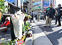 "January 23, 2011, Tokyo, Japan - Flowers are placed at the site of the 2008 stabbing spree in Tokyo's Akihabara district on Sunday, January 23, 2011. After two years and seven months, Akihabara partially reopened ""Pedestrian Paradise"" on a trial basis until June, allowing shoppers and tourists to browse shops and manga stores in Japan's electronics mecca. Police with 50 surveillance cameras along about 230 local citizens kept watch as the 570-meter stretch of the main street was reopened to a record crowd of about 100,000. (Photo by Natsuki Sakai/AFLO) [3615] -mis-"