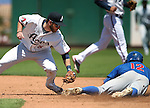 Iowa Cubs' Stephen Perakslis steals safely under the tag of Reno Aces Mike Freeman at Greater Nevada Field in Reno, Nev., on Tuesday, May 17, 2016. The Aces won 5-3. <br />