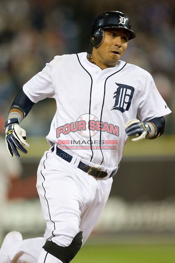 Detroit Tigers' Carlos Guillen (9) hustles around third base versus the Los Angeles Angels at Comerica Park in Detroit, MI, Sunday, April 27, 2008.