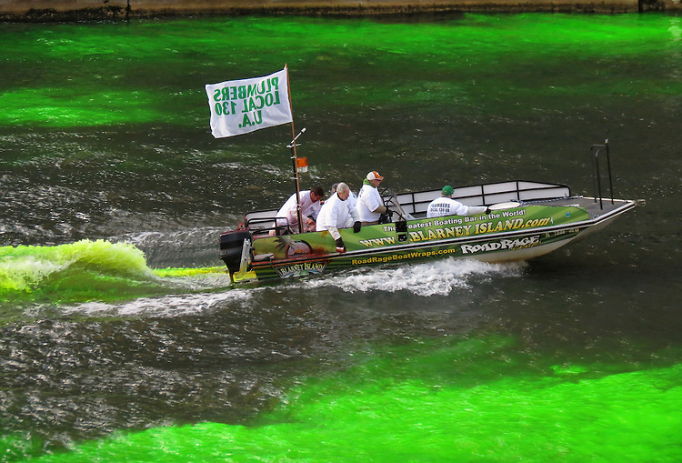 Workers with the Plumbers Local 130 dye the waters of the Chicago River to kick off the 2015 St. Patrick's Day festivities in downtown Chicago. (Photo by Jamie Moncrief)